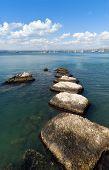 Breakwaters And Blue Sea