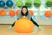 Young Female With Fit Ball In Sport Center