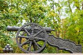 stock photo of cannonball  - Old decorative cannon and cannonballs in park - JPG