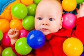 Infant With Colorful Balls