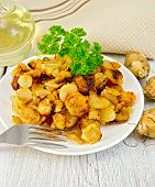 Jerusalem Artichokes Fried With Parsley On Plate