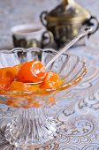 stock photo of kumquat  - Jam from the whole kumquats lies in a glass vase - JPG