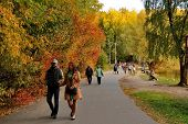 MOSCOW, RUSSIA - SEPTEMBER 28, 2014: Walking people in autumn park