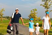Family Of Golf Players Walking
