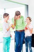 Mother giving children fresh fruits for healthy living