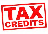 image of subtraction  - TAX CREDITS red Rubber Stamp over a white background - JPG