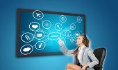 Businesswoman pressing Cloud button on touch screen interface