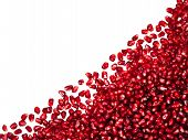 Scattered With Angle Pomegranate Seeds, Can Be Used As A Background, Isolated On A White