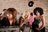 stock photo of lps  - Three female DJs performing at a 1970s Disco Music Party - JPG