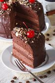 Chocolate Cake With Cherry And A Piece. Vertical