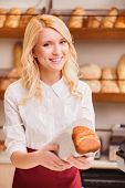 Beautiful young woman in a bakery