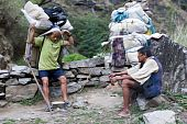Two Porters Carrying Heavy Load