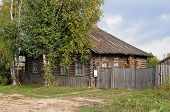 picture of wooden shack  - Old log house with wooden roof in northern russian town Kargopol - JPG