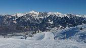 Ski Slope And High Mountains