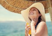 Woman In Big Straw Hat Enjoy With Summer Sun