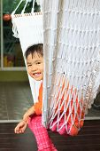 Face Of Children Sitting In Clothes Cradle And Smiling Use For Family Relaxing Time And Warm Home