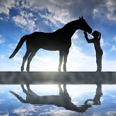 pic of horse girl  - Silhouette of a girl giving a kiss horse in sunset - JPG