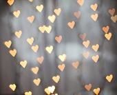 a nice background with defocused lights blurred into the shape of hearts good for holidays like valentine's day or wedding announcements or romantic cards