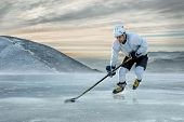 image of ice hockey goal  - Ice hockey player on the ice in mountains - JPG