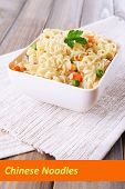 Chinese noodles in bowl with vegetables and space for your text