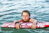 Boy Exhausted From Surfing
