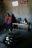 Internal View Masai Home, Black Girl With Baby Are Indoors.