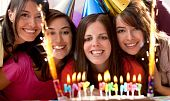 stock photo of birthday-cake  - Group of women at a birthday party having fun and holding the cake - JPG