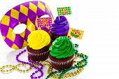 foto of icing  - Cupcakes decorated with bright color icing for Mardi Gras party - JPG