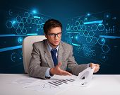 Young businessman doing paperwork with futuristic backgroung
