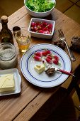 foto of radish  - plate with radish and butter on a table - JPG