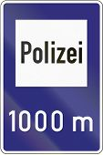 foto of police  - Old design of a German sign giving the distance to the next police station - JPG