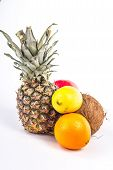 isolated group of tropical fruits - pineapple, coconut and citrus