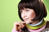 Mature woman posing wearing a colorful sweater