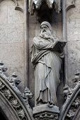 VIENNA, AUSTRIA - OCTOBER 10: Statue of Saint, Votivkirche (The Votive Church). It is a neo-Gothic church in Vienna, Austria on October 10, 2014