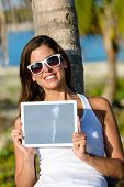 Woman On Tropical Vacation Holding Digital Tablet