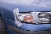 Car Accident, Insurance Concept With Adhesive Tape On Lights