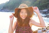 Portrait Face Of Beautiful Woman Wearing Wide Straw Hat Standing At Sea Side Eyes Looking To Camera