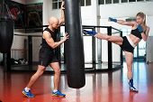 Man and woman training next to a punching bag