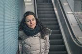 Beautiful Young Brunette Posing In A Metro Station