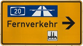 stock photo of long distance  - German road sign showing the way to the next Autobahn industrial area and general long - JPG