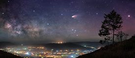 image of cosmic  - Panoramic picture of starry night sky over mountain town - JPG