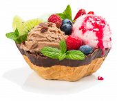 foto of chocolate-chip  - Berry and chocolate ice cream with fresh fruits decorated with fresh fruits sauce and chocolate chips - JPG