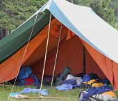 pic of sleeping bag  - large tent of boy scout camp with backpacks and sleeping bags - JPG