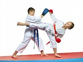 pic of karate kid  - Boy and girl in karategi are training paired exercises karate - JPG