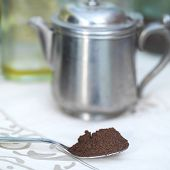 stock photo of coffee grounds  - Spoon full of ground coffee closeup shot with shallow depth of field  - JPG