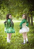 pic of wig  - Two young beautiful girl in irish dance dress and wig posing outdoor