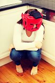 stock photo of abused  - Young woman in fear of domestic abuse - JPG