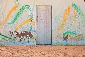 pic of paint spray  - old wall on the sand of the beach with colored spray of paint  - JPG