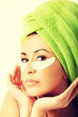 image of gels  - Spa serene woman with gel eye mask and hands on chin - JPG