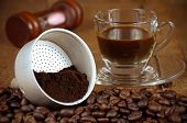 foto of spit-roast  - Presurize Coffee Filter with Roasted and Grounded Coffee Beans Makes an Espresso Shot - JPG
